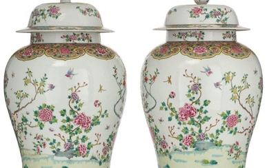 A pair of large famille rose vases and...
