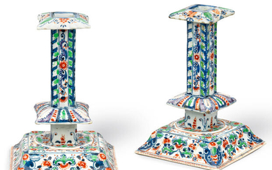 A pair of rare Delft-style famille verte silver-shaped candlesticks