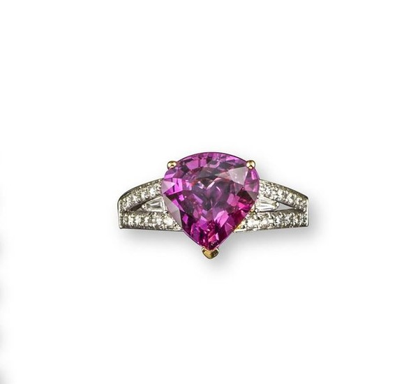 A pink sapphire and diamond ring, set with...