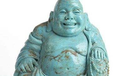 A turquoise sculpture depicting a smiling Buddha. Dimensions 69.7 x...