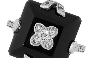 AN ONYX AND DIAMOND DRESS RING in Art Deco design