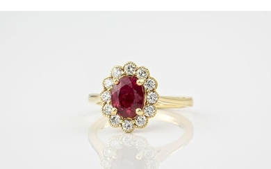 An 18ct yellow gold, ruby and diamond cluster ring, featurin...