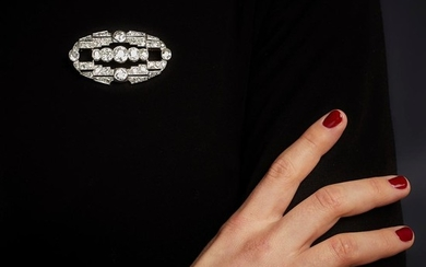 An Art Deco, diamond and platinum brooch.