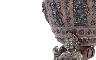 An Indian bronze and silver inlaid lamp base supported by 3 ...