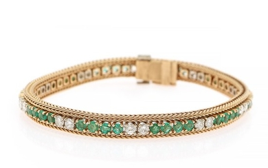 An emerald and diamond bracelet set with numerous circular-cut emeralds and brilliant-cut diamonds, mounted in 18k gold. Circa 1950–1960. L. 18.5 cm.