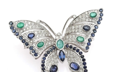 NOT SOLD. An emerald, sapphire and diamond brooch set with five emeralds, numerous sapphires encircled...