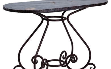 An oval wood and wrought iron table