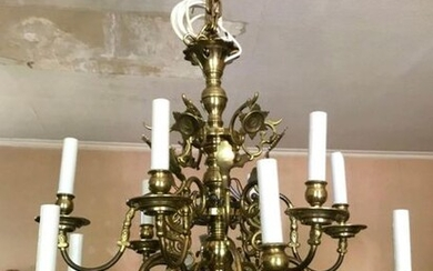 Antique Dutch chandelier with twelve brass lights.