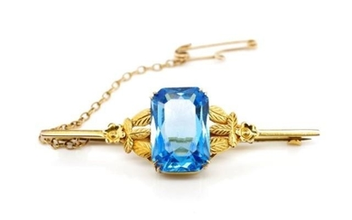 Arts & crafts yellow gold and blue glass brooch marked 9ct. ...