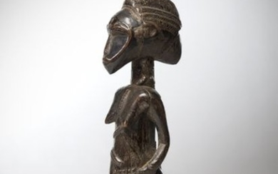 BAOULE, Ivory Coast. Female statue with elongated face...