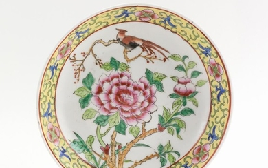 CHINESE FAMILLE ROSE PORCELAIN DISH With central peony and phoenix decoration surrounded by a famille jaune border. Six-character Qi...