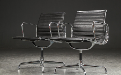 Charles Eames. A pair of armchairs / office chairs model EA-108, black leather (2)