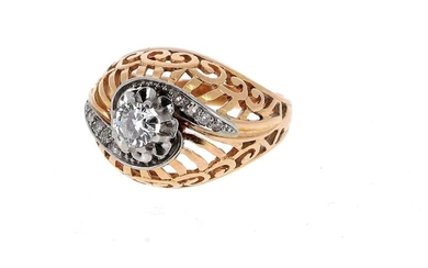 Dome ring in 18 K (750 °/°°°) yellow and white gold and platinum (950 °/°°) with openwork decoration, set with a brilliant of about 0.50 ct and small old cut diamonds.