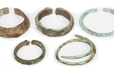 Five Chinese bronze bracelets, Neolithic period, three with woven decoration,...
