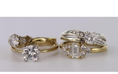 Four 9ct yellow gold cz set dress rings, total weight 9.1g