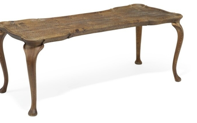Frits Henningsen, attributed: Coffee table of carved, patinated oak with cabriole legs. Curvy top with raised edges.