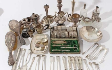 Group of Georgian and later silver to include flatware, miniature trophies, candlesticks, silver mounted sauce bottle, napkin rings and other silver and white metal items, (various dates and makers)