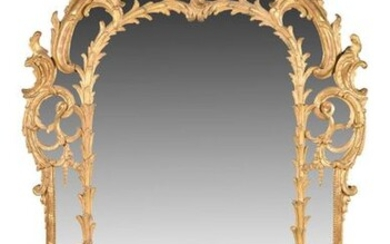 MIRROR WITH PARECLOSES in carved and gilded wood decorated with foliated scrolls, palms, staples, acanthus leaves, volutes. The pediment is surmounted by a large half shell