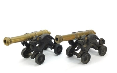 Pair of early 20th century bronze and cast iron cannons, eac...