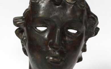 School of the 20th century in the taste of the antique. Head of Apollo. Bronze with brown patina treated in bas-relief. H. 47 cm