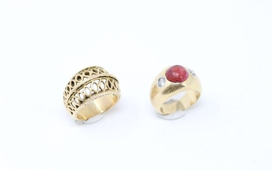 Set of two 18k (750) yellow gold rings, one openworked and the other decorated with a ruby cabochon and two brilliants.