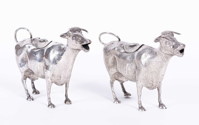Two similar Victorian silver cow creamers, lacking maker's mark, London 1884
