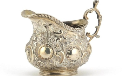 Victorian silver cream jug embossed with flowers