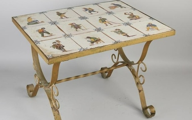 Wrought iron table with antique Makkum polychrome