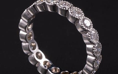 18 kt. White Gold and Diamond Eternity Ring