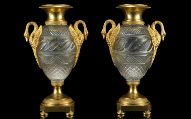 A pair of early 19th century Russian gilt bronze and cut glass vases
