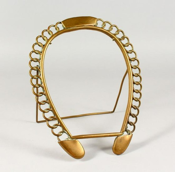 A BRASS HORSESHOE SHAPED PHOTOGRAPH FRAME. 12ins high.