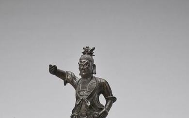 A BRONZE FIGURE OF A TEMPLE GUARDIAN, MING...