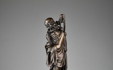 A BRONZE FIGURE OF AN EMACIATED IMMORTAL, 17TH...