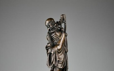 A BRONZE OF AN EMACIATED IMMORTAL, 17TH CENTURY