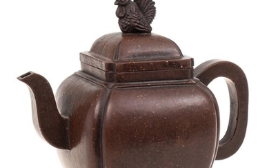 A Chinese Yixing stoneware teapot: of dark brown burnished f...