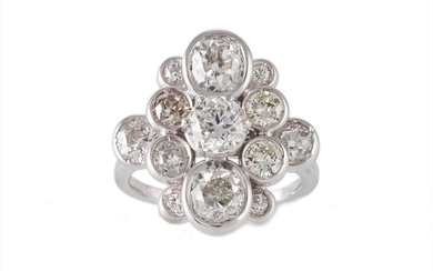 A DIAMOND CLUSTER RING, with centre round brilliant cut diam...