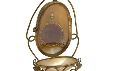 A FRENCH C1890'S WATCH STAND WITH MOTHER OF PEARL, GILT FRAME AND GLASS DOOR ON A MARBLE BASE