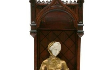 A GILT-BRONZE ART DECO FIGURINE: A SEATED GIRL
