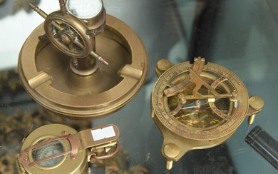 A GROUP OF THREE BRASS COMPASSES