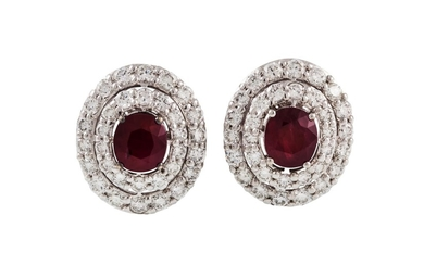 A PAIR OF RUBY AND DIAMOND CLUSTER EARRINGS, the oval rubies...