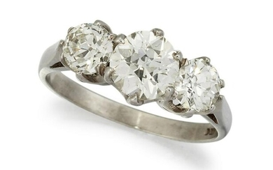 A PLATINUM THREE STONE DIAMOND RING, the three slightly
