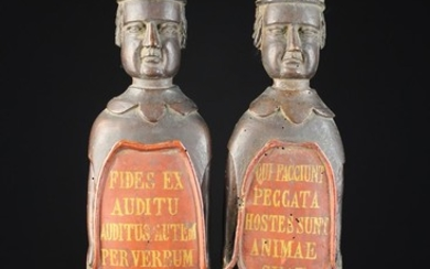 A Pair of Unusual & Quirky Early 18th Century Relief Carved Figures bearing painted cartouches with