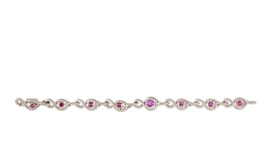 A RUBY AND DIAMOND BRACELET, the oval rubies and brilliant c...