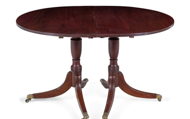 A Regency Style Mahogany Double Pedestal Extension Dining Table