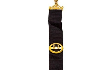 A Yellow Gold Fob with Attached Charms,