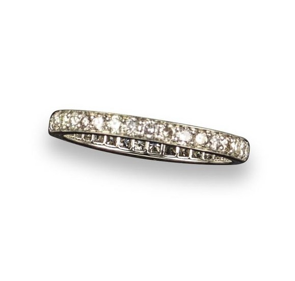 A diamond eternity ring, set with round brilliant-cut...