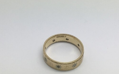 A gold ring set with diamond chips, assay marks indistinct, ...