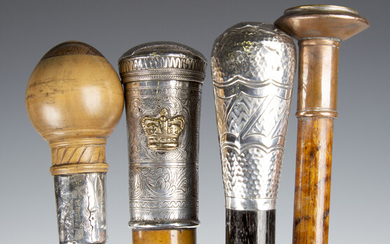 A group of four walking canes, including a 19th century Malacca walking cane with Burmese engraved w