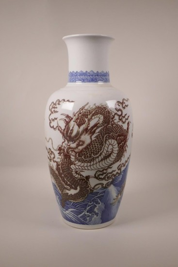 A large Chinese blue and white porcelain vase decorated with...