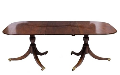 A mahogany twin pillar dining table in the Regency taste:, t...